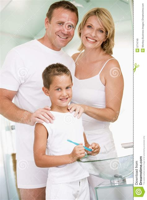 couples in bathroom couple in bathroom with young boy brushing teeth royalty free stock images image