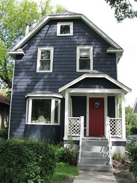 blue house with red door dark blue house white trim red door house exterior