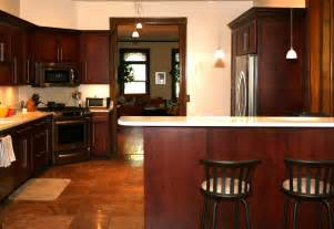 beautiful Kitchen Tile Under Cabinets #8: Brilliant-Kitchen-Paint-Colors-with-Cherry-Cabinets-and-Oak-Bar-Counter-beside-Black-Stools-on-Brown-Ceramic-Tile-Flooring.jpg