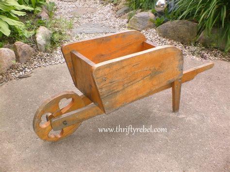 How To Make A Wheelbarrow Planter by Easy Distressed Wheelbarrow Planter Thrifty Rebel Vintage