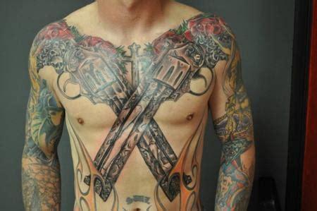 tattoo chest gun guns by nick clark tattoos
