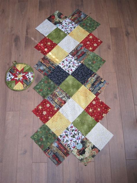 charm pack table runner another table runner made with a charm pack and pot holder table runner still needs to