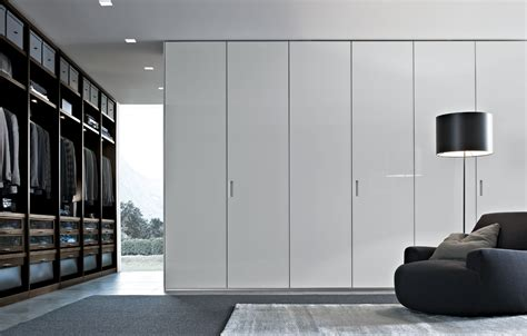 white poliform closet with six doors for master