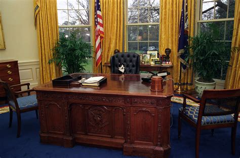 presidential desk in oval office photograph of socks the cat sitting behind the president s