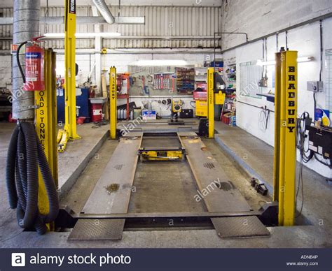 car garage mechanic car repair garage with hydraulic car lift stock photo