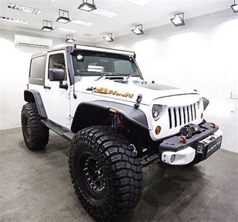 Lifted 2 Door Jeep With Rims And Tires Trucks Vans And