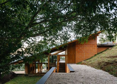 contemporary hillside home in brazil disappears into the landscape as 25 melhores ideias de hillside house no pinterest