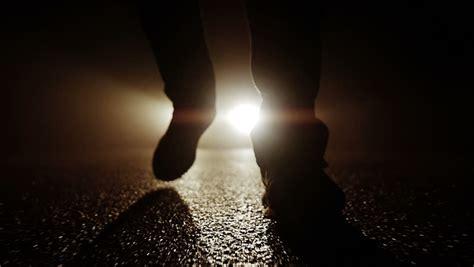 light for walking at night close up of man feet walking on walk at night