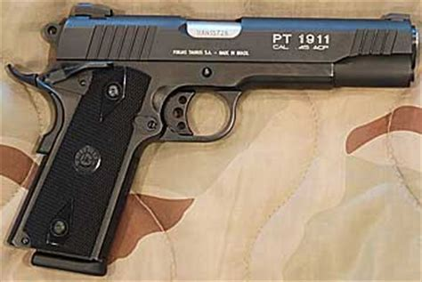 taurus pt1911 .45 pistol. one good review. one bad review