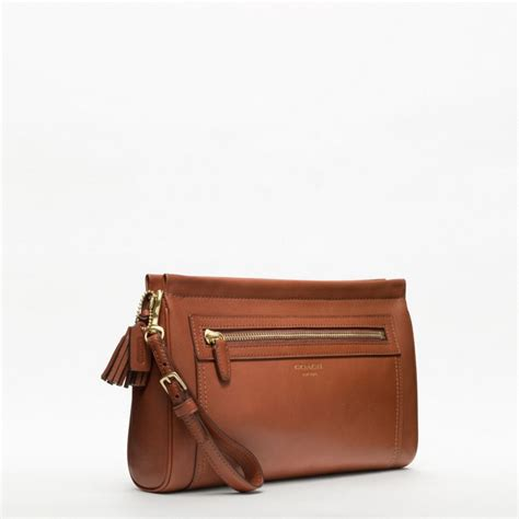 couch clutch coach legacy leather large clutch in brown lyst