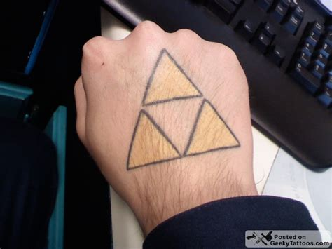 hand tattoo triforce triforce tuesday a triforce on the hand is worth geeky