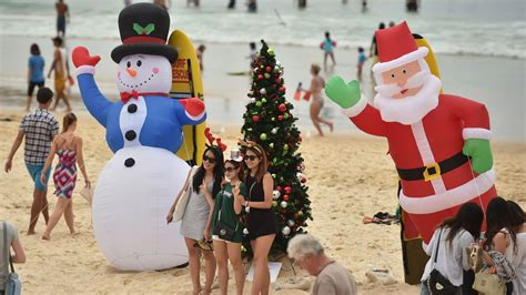 christmas in australia means sweaty santas and prawns galore