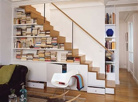 understair storage with glass and wood railing