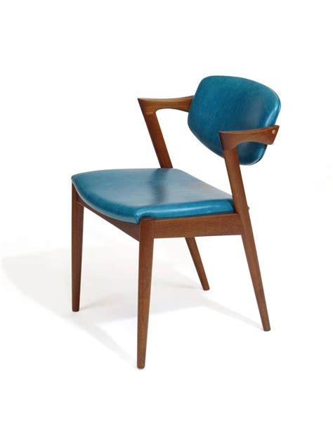 six kristiansen teak dining chairs in turquoise