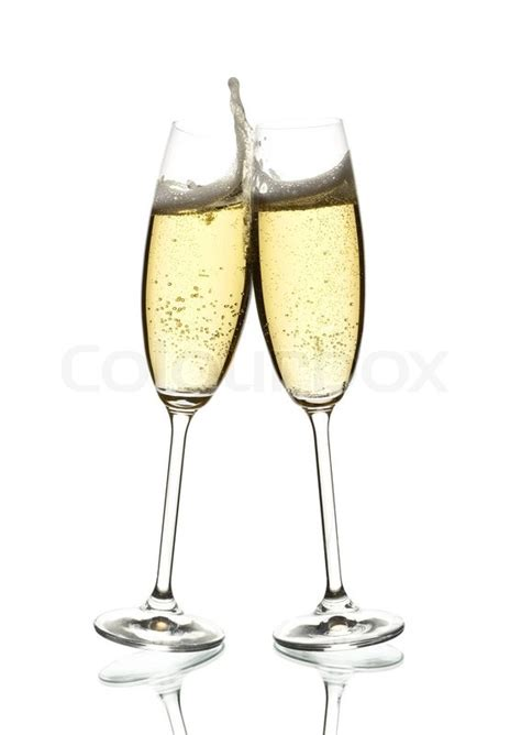 Two Glasses Of Sparkling Wine Clinking Over White