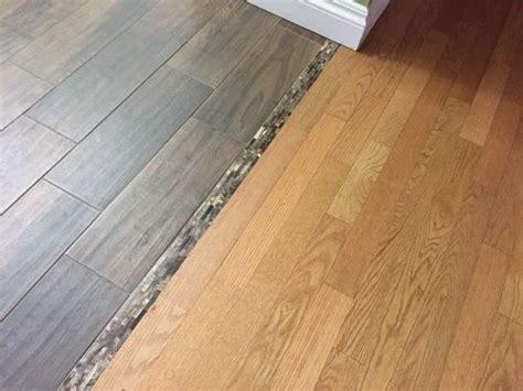 wood flooring types the 25 best transition flooring ideas on tile in kitchen floor tile floor kitchen