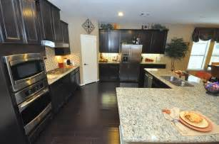 kitchen cabinets and light granite countertop