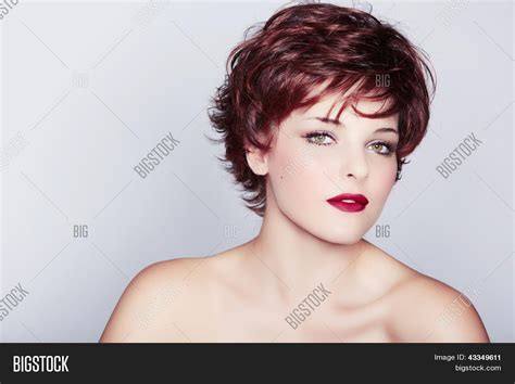 red short cropped hairstyles over 50 beautiful young woman red hair image photo bigstock