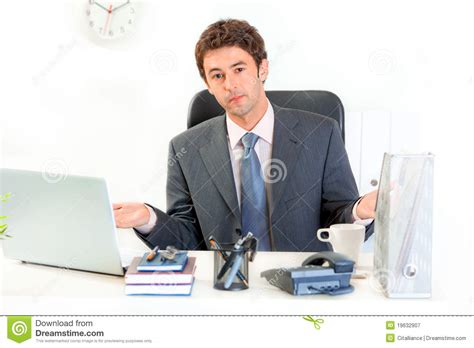 Man Sitting At A Desk Confused Business Man Sitting At Office Desk Royalty Free