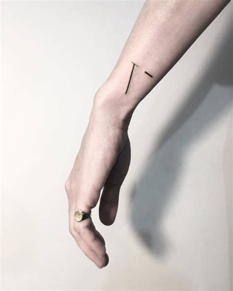 minimalist tattoo on wrist minimalist v letter tattoo on the wrist tattoo artist