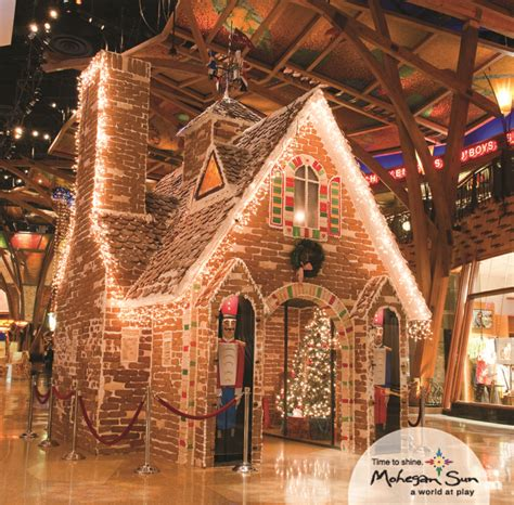 life size gingerbread house decorations our life size gingerbread house in the shops is made of 4 280 pounds of icing 5 000