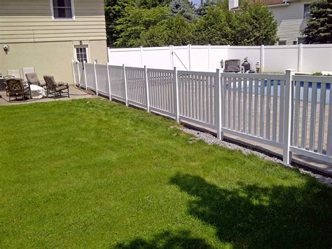 vinyl columbia yard fence installed around an inground pool in utica ny by poly enterprises
