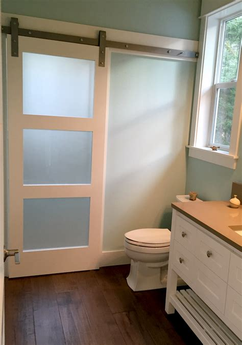 bedroom door with window frosted glass barn door adds privacy to shower room on