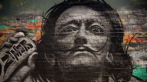 graffiti walls bricks men salvador dali face