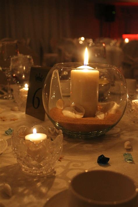 wedding centerpieces with candles and sand themed centerpiece glass bowl with quot sand quot sea shells and candle event by mj