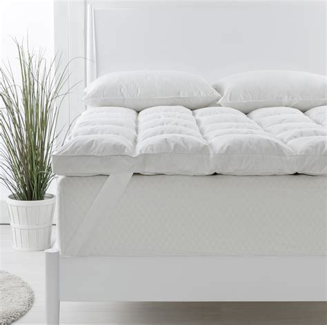 live comfortably cuddlebed mattress topper mattress topper our pick resting on a mattress with