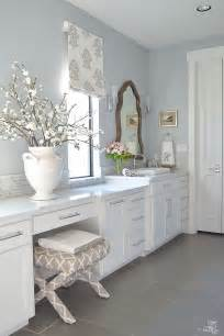 Transitional white bathroom white cabinets carrara marble counter tops