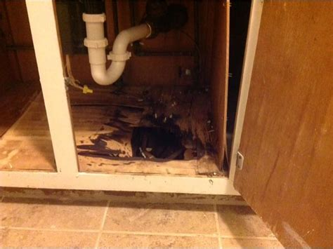 water damaged kitchen cabinets kitchen cabinet pipe burst