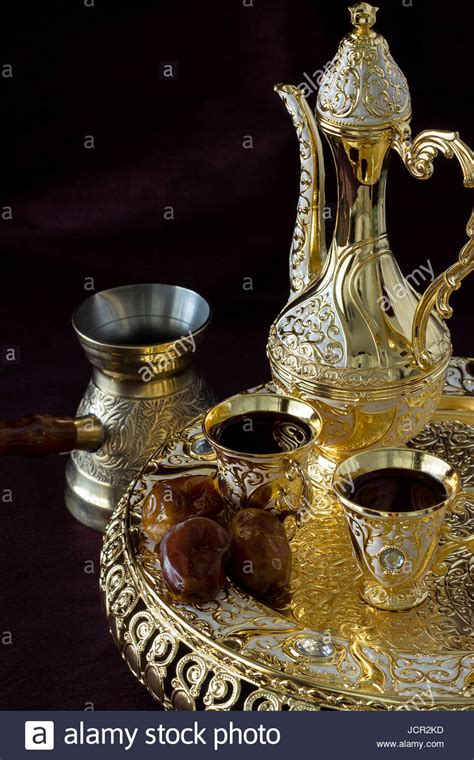 Arabic Set still with traditional golden arabic coffee set with