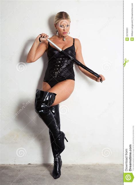 beautiful woman  high heels holding  whip stock image