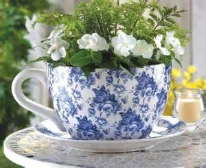 large tea cup and saucer planter blue roses country