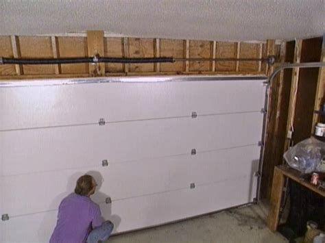 How To Install Overhead Garage Door Installing A Garage Door How Tos Diy