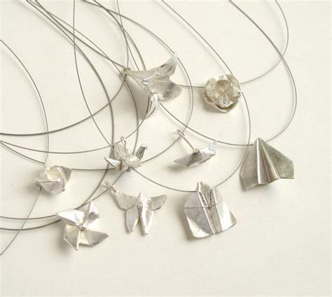 Origami Jewelry Home - 25 best ideas about origami necklace on