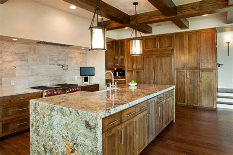 kitchen exposed beams waterfall granite countertops mediterranean kitchen austin by