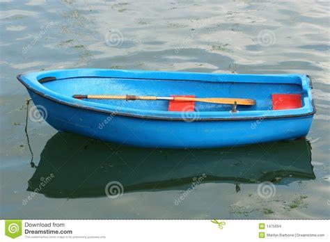 empty blue rowing boat stock photo image  reflection