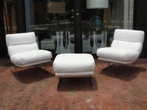pair of kipp stewart white leather chairs and ottoman at