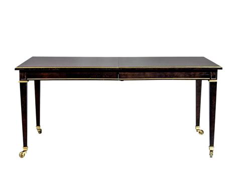 walnut dining table with gold trim accents at 1stdibs