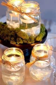 mason jar centerpieces jars and floating candles on pinterest
