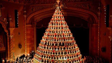 high school choir performs as 67 foot singing christmas