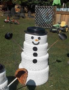 hometalk the snowman family made from tires