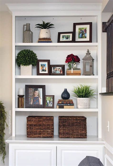 built in shelves living room styled family room bookshelves shelving room and living