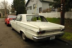 parked cars 1966 dodge dart 270