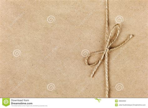 String On Paper - string or twine in a bow on kraft paper stock image