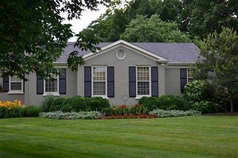 grey painted brick house grey painted brick ranch house love the color and the shutters for the home