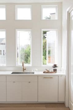 this inviting kitchen features flat front white cabinets chic cottage kitchen features white flat front cabinets