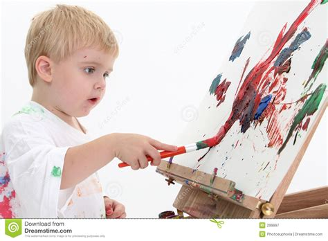 painting boy adorabletoddler boy painting at easel royalty free stock